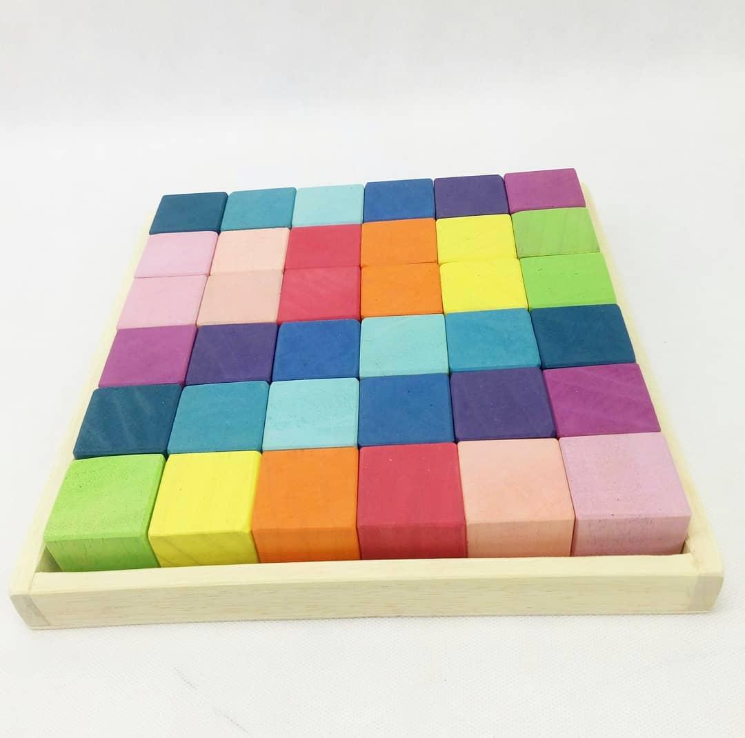 cubos de madera colores pastel. ukitu juguetes.